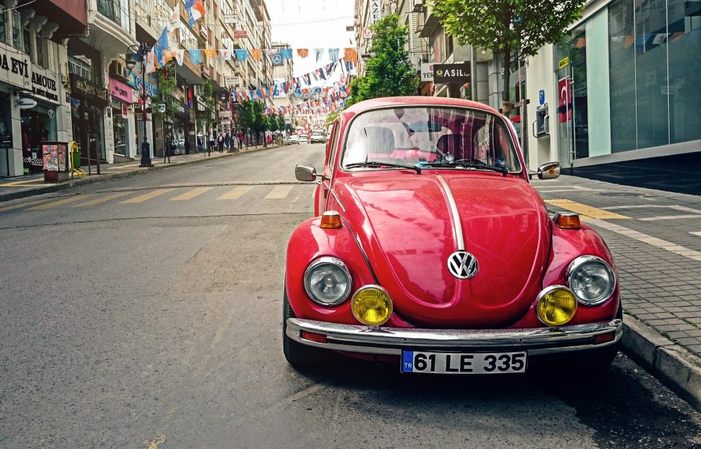 A red VW beetle in an alley