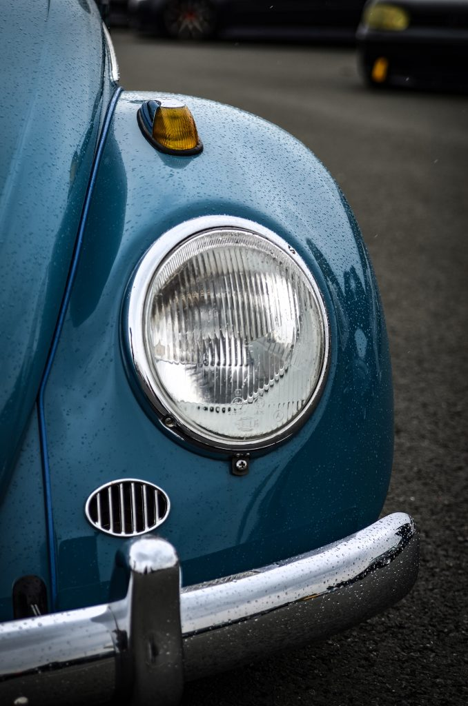 Close-up of a blue vw beetle's light